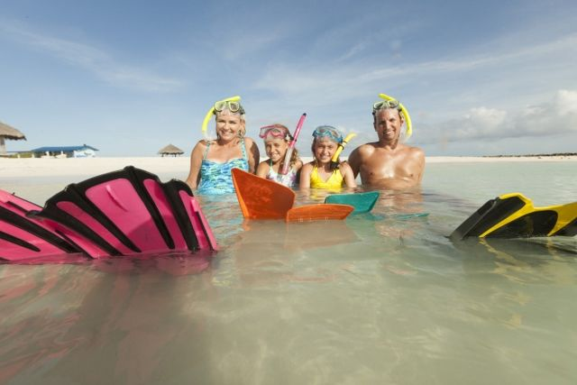 activities_family_snorkeling_on_the_shoreline_at_b