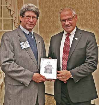 Doug Fenichel, APR, left, receives his award from Dom Paragano.