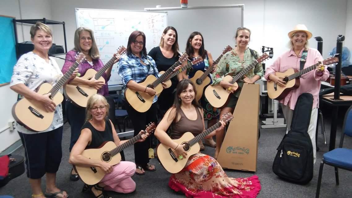 Teachers learn to play Martin Guitars at a GITC Teacher Training Workshop