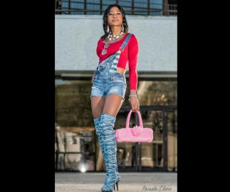 Pamela E'bere with her custom handbag
