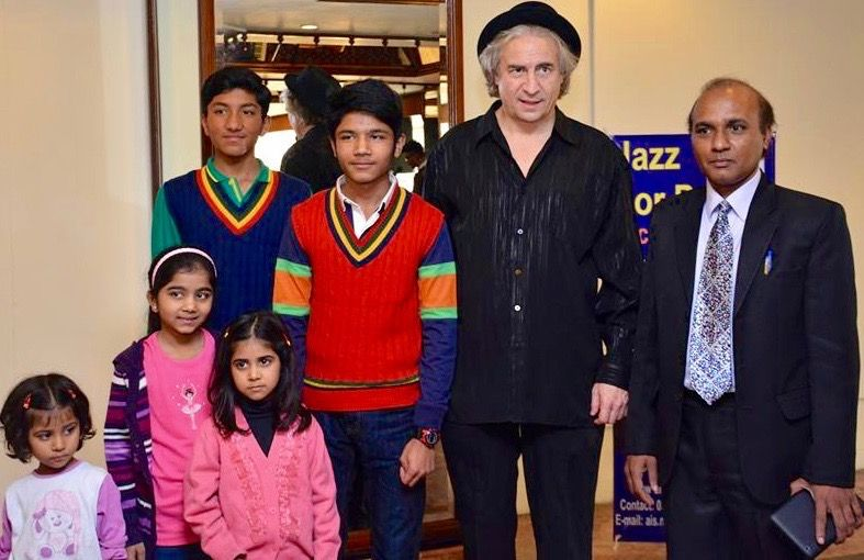 R-L: Aamir Isaac Sindhu with Jazz for Peace Founder Rick DellaRatta and children