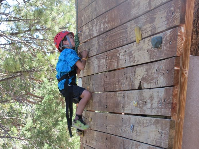 Camper on Climbing Wall