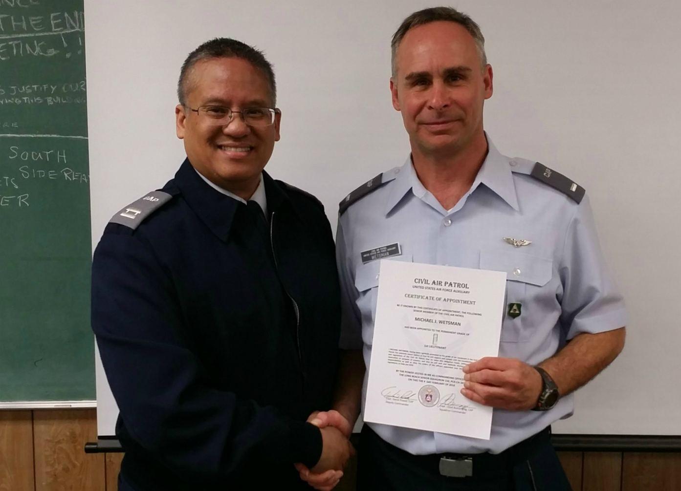 Capt. Lloyd Bumanglag (L) congratulates 1st Lt. Michael Wetsman (R)