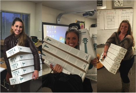 Guitars in the Classroom teachers happily picking up Waterman Ukuleles