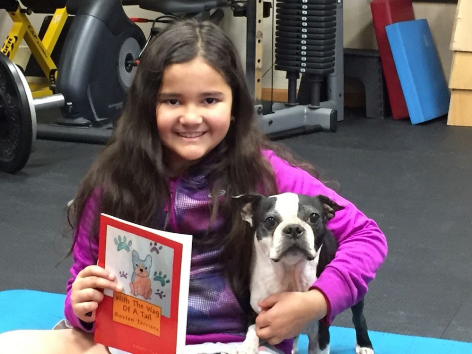 Anjali Anabel Tomerlin with Diesel the dog, the inspiration for her first book.