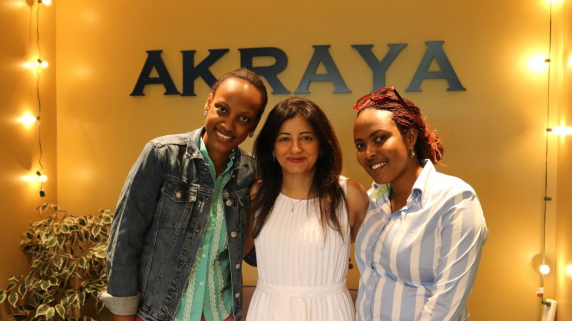 Sonu Ratra with 2015 Graduates Dianne Dusaidi (left) and Divine Umubyeyi (right)