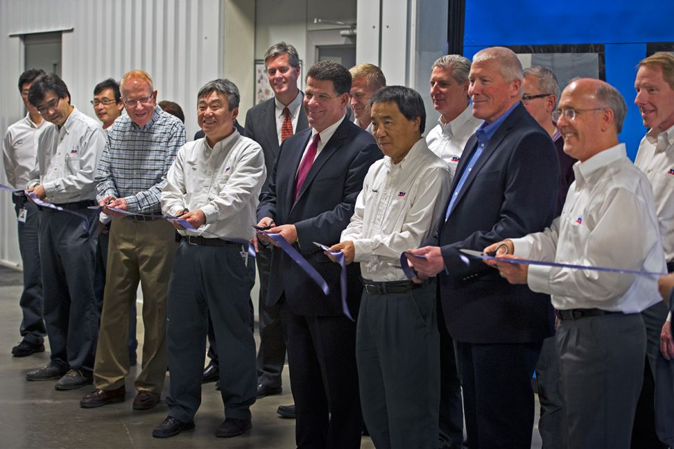 Local officials join SIA leaders to cut the ribbon on SIA's new paint shop.