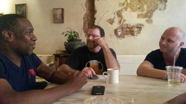 Romain Battaglia (right) discusses the score with Cedric Hill and Bob Messinger