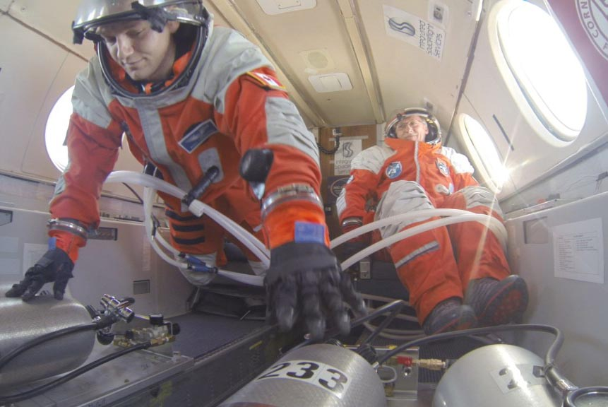 PoSSUM candidates test spacesuit pressurization systems in microgravity