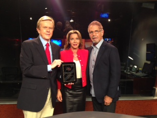 Dr.'s Tad and Adriana James with Doug Llewelyn