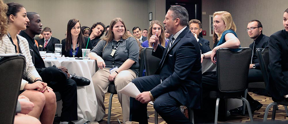 Dave gets interactive during his seminar with Collegiate DECA student leadership