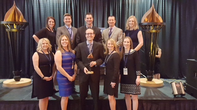 CEO Matt Ostanik and some of the FunnelWise team at the Prometheus Awards