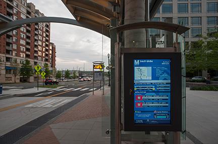 Redmon Group LCD Transit Display at a bus stop