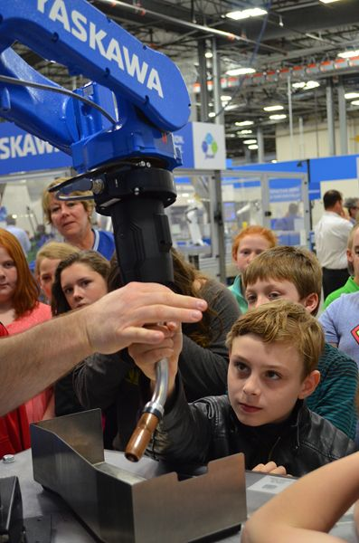 Students Learn to Program a Robot via Kinetiq Teaching