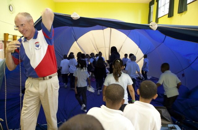 Students explore the interior of the RE/MAX Hot Air Balloon.