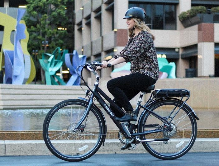 A Pedego commuter smiles on her way to work.