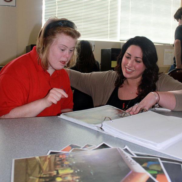 Transition Educator Award winner Megan Feeney assists a Pathways participant
