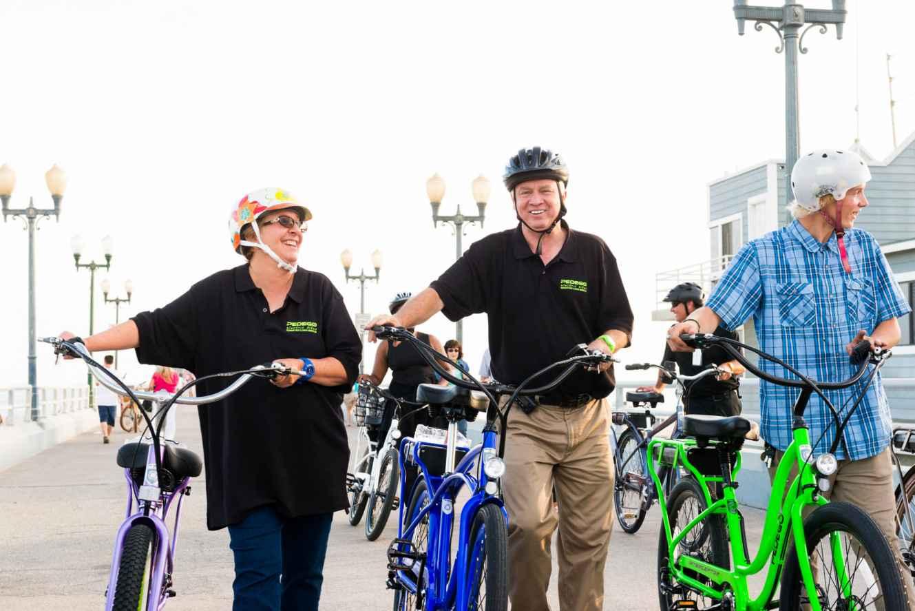 Beth Black and Brian Ballard lead a group of Pedego riders in Seal Beach.