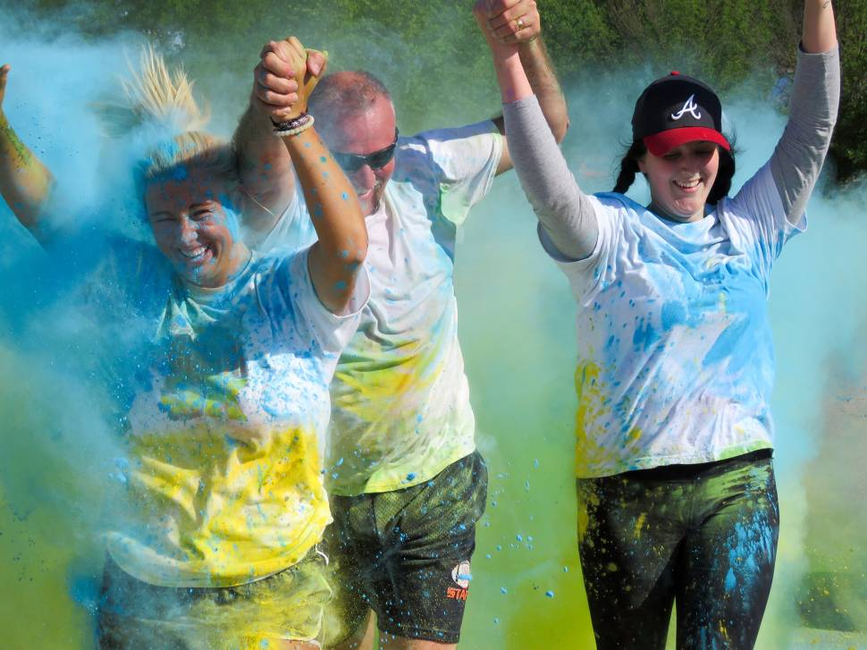 Runners are covered in multiple colors during the second annual Subaru Color 5k.