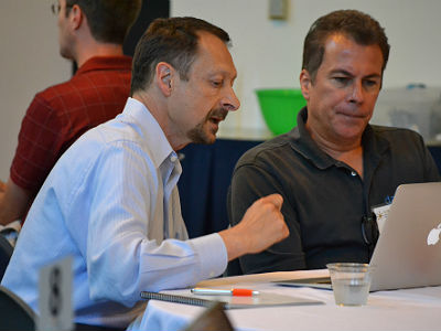 Datacate VP Ed LaFrance (right) works with Academy participant Tony Simon