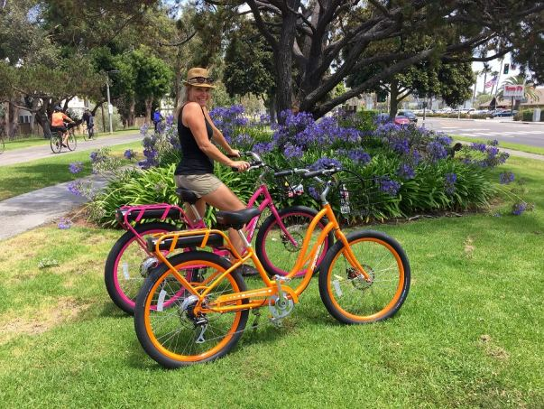 Pedego MdR co-owner Jennifer Cullen shows off colorful Pedego bikes.