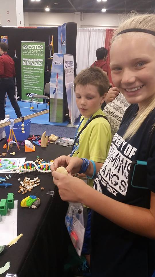 Children at MyStemKits booth engaged with 3D printed Kits at NSTA