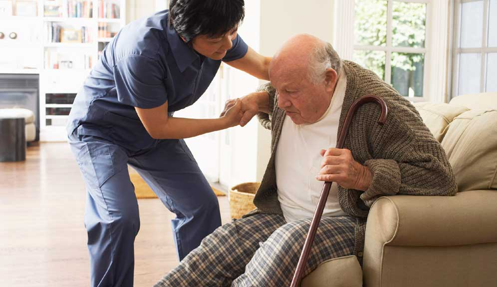 Caregiver assisting with mobility