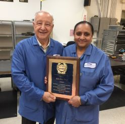 NJMET President Jim Federico congratulates Kanchan Patel on 20 years at NJMET