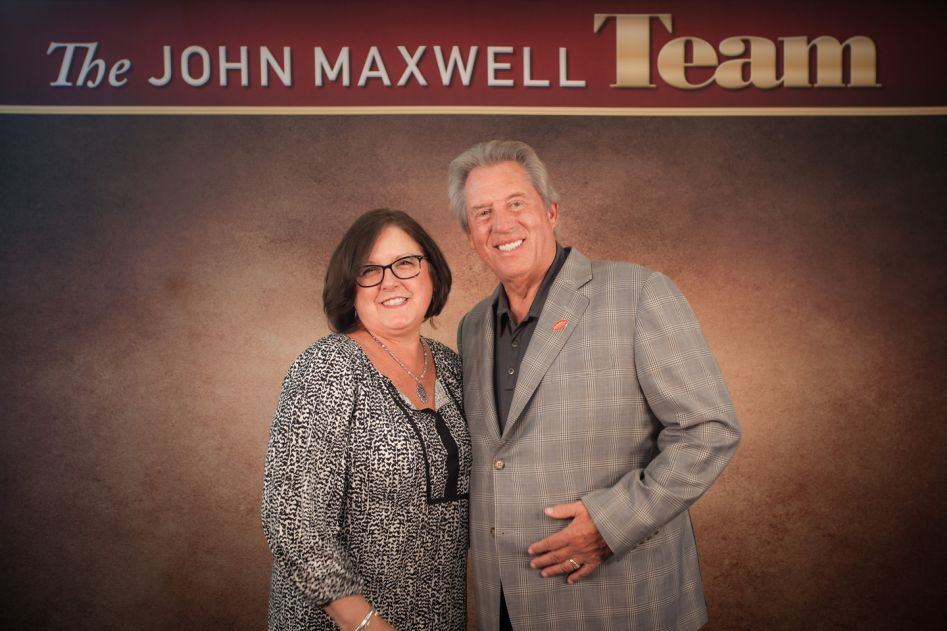 Dr. Suzanne Bryant Miller receives JMT certification from Dr. John C. Maxwell