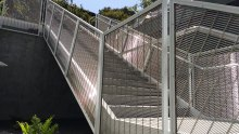 Banker Wire's M13Z-145 woven wire mesh as railing infill