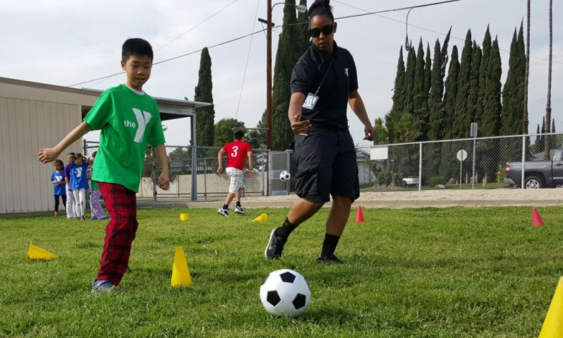 EAB participant learning soccer