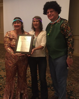 Claudia Yundt, left, is recognized by the National Cave Association