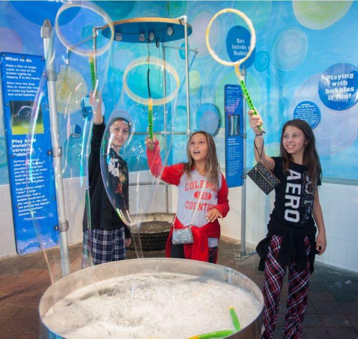Guests enjoy the Bubbles Exhibit at the Long Island Children's Museum.