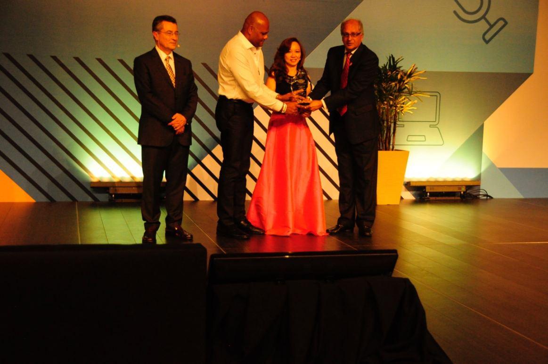Matthew Rajendra, CEO and Avis Tan, CFO receiving the award