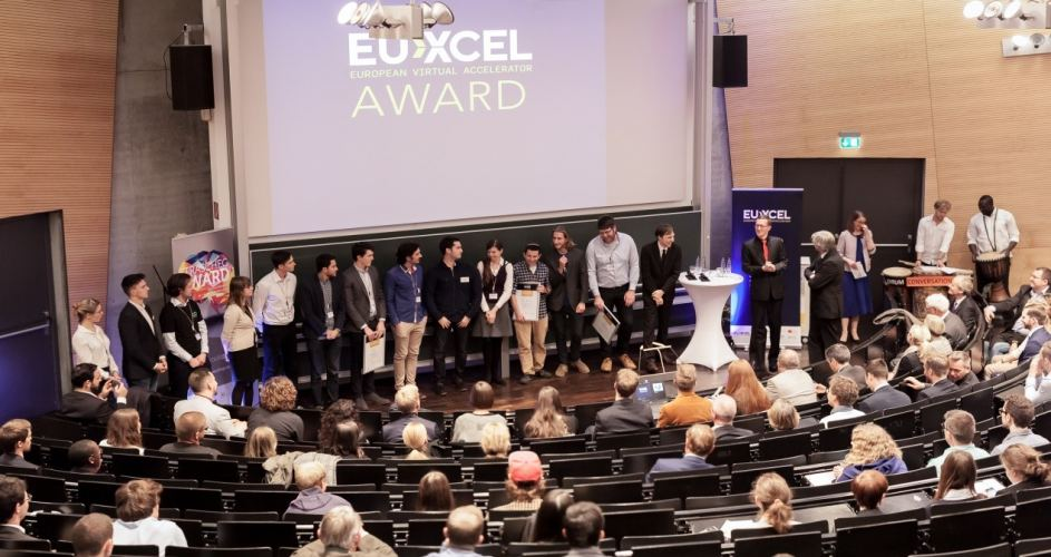 All 14 EU-XCEL finalists on stage for the award