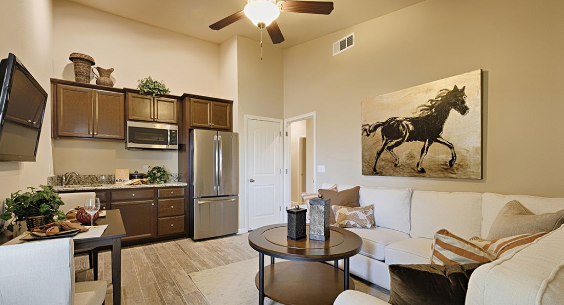 Inside the living room and kitchenette area of a Lennar Next Gen suite.