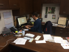 GiftsForYouNow CEO Jim Tuchler filling out customer mail orders by hand