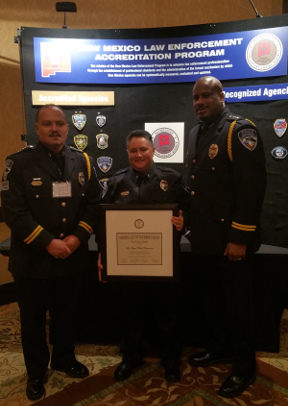 Representatives of the LVPD receive accreditation . From left, Chief Juan