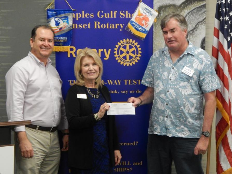 Howard Isaacson, Dianne Reed accept check for $5,000 from Rob Samouce
