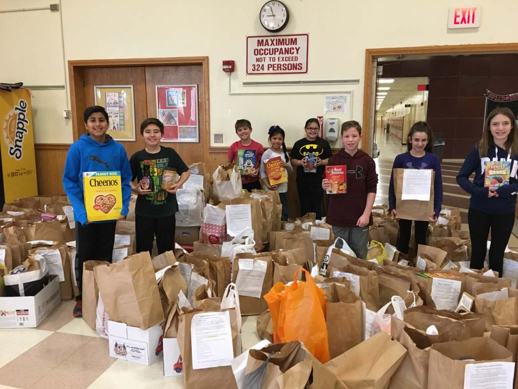 Students from Island Trees School District pose with their food donations.