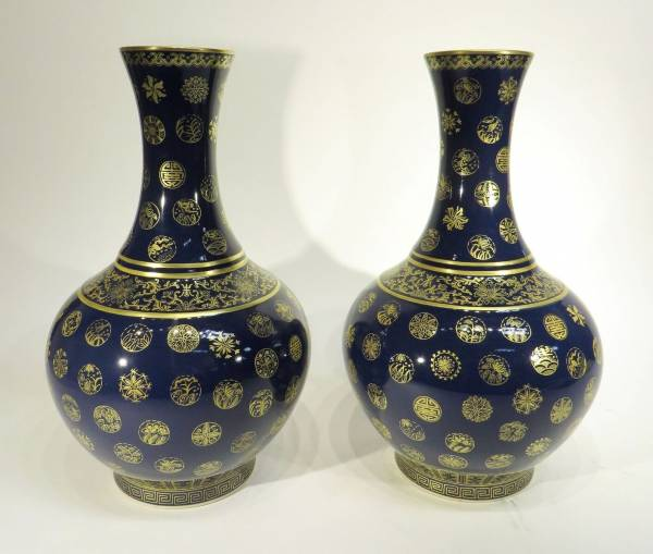 Pair of Guang Xu marked gilt porcelain and cobalt glazed vases (est. $500-$800).