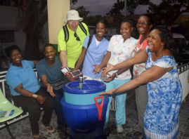 The team smiles with a new Life Straw for the hospital in Port Salut.