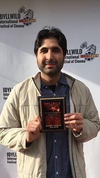Armin Nassseri holds the Indie Spirit Award