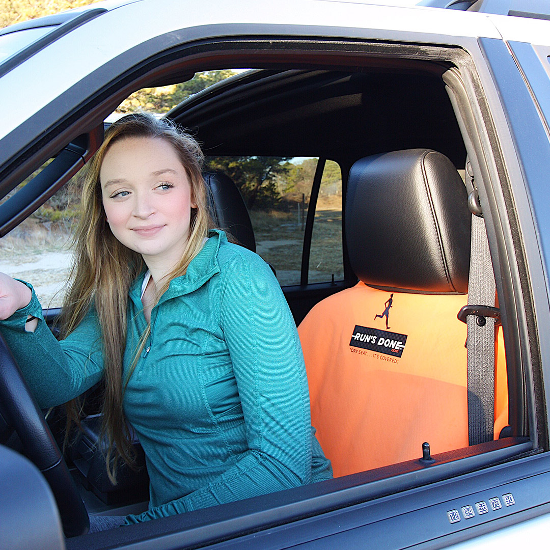 A happy Run's Done customer using her Sports Towel Seat Cover