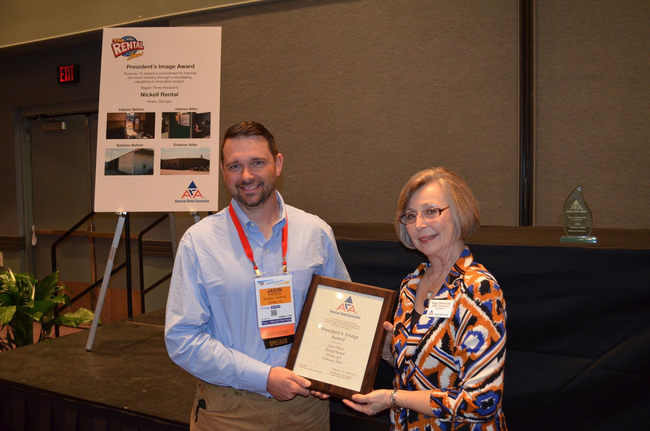 Jason Pierce accepts award from ARA Region Three Director, Peggy DeFrancisco