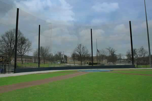 Baseball field with tie-back back-up netting