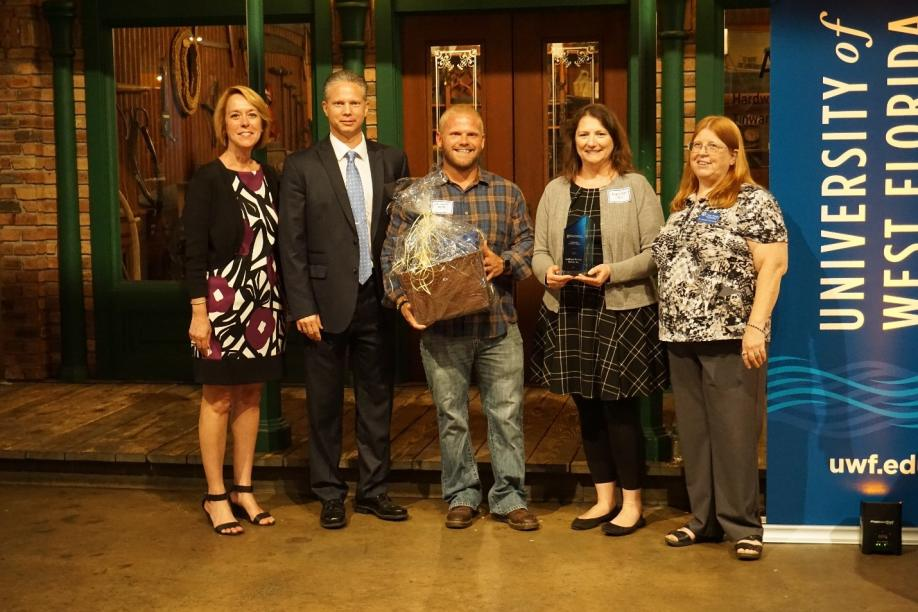 IDSI IDs Receive Recognition Award from UWF Representatives