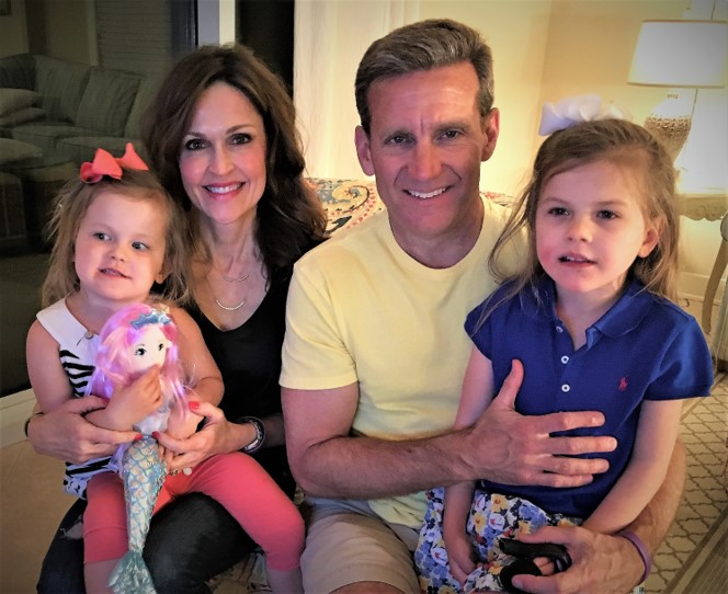 Kevin pictured with wife Sonja and granddaughters Andi Mac and Blakely