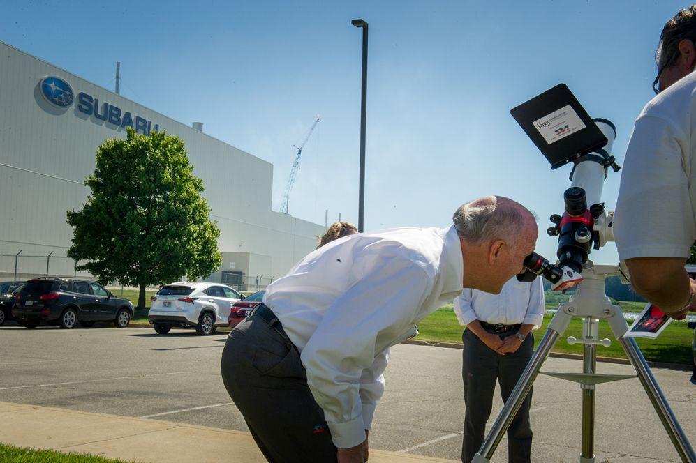 SIA's Sr. EVP, Tom Easterday looks through a grant-funded solar telescope.