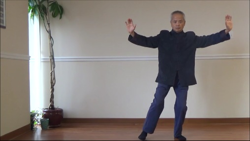 Dr Wu moving into the Tai Chi cross hands position